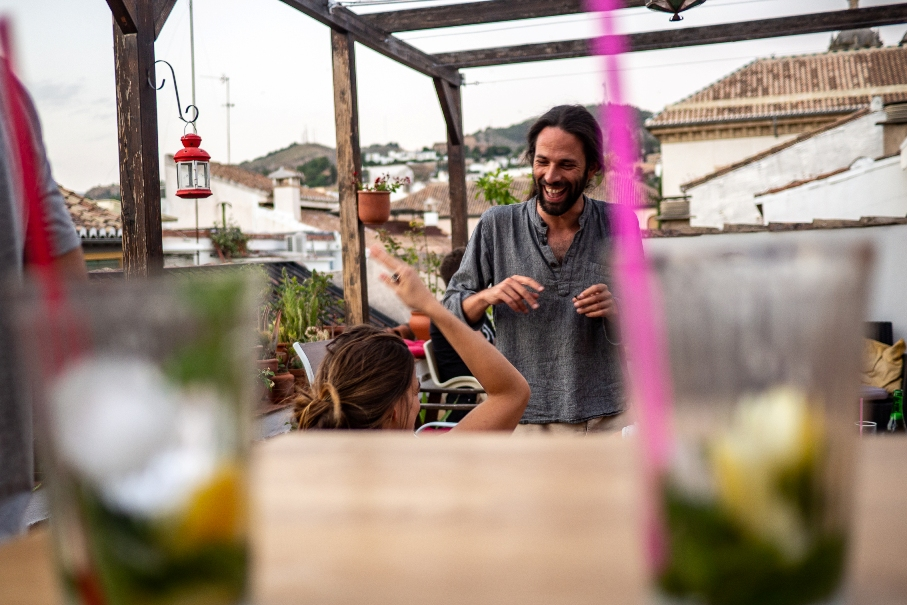 Guests socializing on rooftop terrace